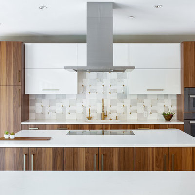 Inspiration for a huge modern galley porcelain tile and gray floor eat-in kitchen remodel in Dallas with a single-bowl sink, flat-panel cabinets, medium tone wood cabinets, quartz countertops, gray backsplash, marble backsplash, stainless steel appliances, two islands and white countertops