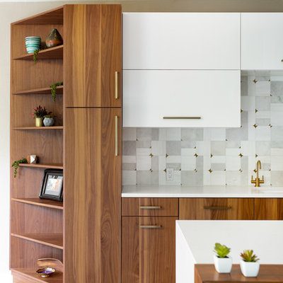 Huge minimalist u-shaped porcelain tile and gray floor eat-in kitchen photo in Dallas with a single-bowl sink, flat-panel cabinets, medium tone wood cabinets, quartz countertops, gray backsplash, marble backsplash, stainless steel appliances and white countertops