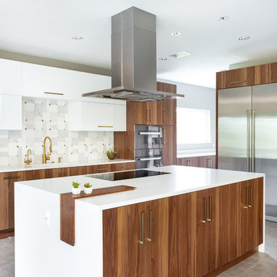 Eat-in kitchen - huge modern l-shaped porcelain tile and gray floor eat-in kitchen idea in Dallas with a single-bowl sink, flat-panel cabinets, medium tone wood cabinets, quartz countertops, gray backsplash, marble backsplash, stainless steel appliances, white countertops and an island