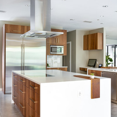 Eat-in kitchen - huge modern u-shaped porcelain tile and gray floor eat-in kitchen idea in Dallas with a single-bowl sink, flat-panel cabinets, medium tone wood cabinets, quartz countertops, gray backsplash, marble backsplash, stainless steel appliances, two islands and white countertops