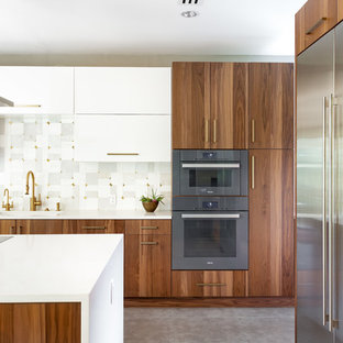 Photo of an expansive modern u-shaped eat-in kitchen in Dallas with a single-bowl sink, flat-panel cabinets, medium wood cabinets, quartz benchtops, grey splashback, marble splashback, stainless steel appliances, porcelain floors, multiple islands, grey floor and white benchtop.