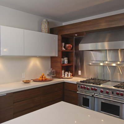 Example of a trendy kitchen design in Dallas with stainless steel appliances, flat-panel cabinets, dark wood cabinets, metallic backsplash and metal backsplash