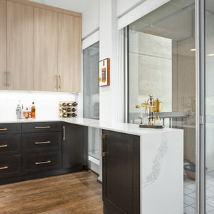 Small contemporary kitchen designs - Inspiration for a small contemporary medium tone wood floor and brown floor kitchen remodel in Dallas with an undermount sink, shaker cabinets, black cabinets, quartz countertops, white backsplash, ceramic backsplash, stainless steel appliances and white countertops