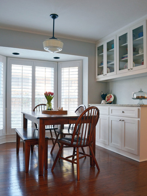 Traditional Medium Tone Wood Floor Kitchen Idea In Dallas With Glass Front Cabinets And White