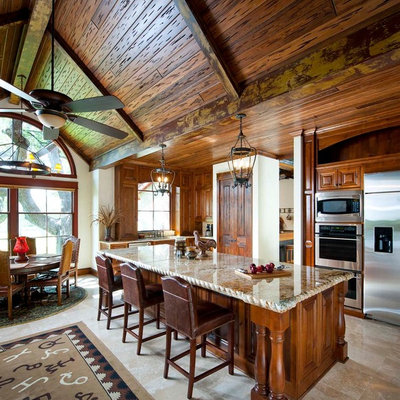 Kitchen - rustic kitchen idea in Dallas with stainless steel appliances