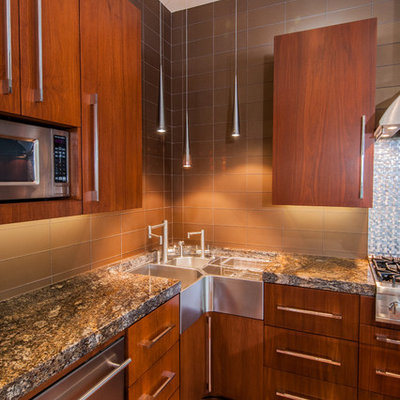 Example of a trendy galley eat-in kitchen design in Dallas with a farmhouse sink, flat-panel cabinets, medium tone wood cabinets, granite countertops, metallic backsplash, stainless steel appliances and glass tile backsplash