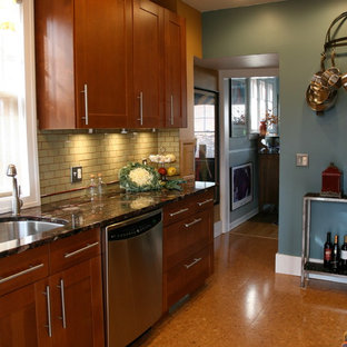 Small transitional eat-in kitchen pictures - Example of a small transitional galley cork floor eat-in kitchen design in Detroit with a single-bowl sink, shaker cabinets, medium tone wood cabinets, granite countertops, green backsplash, ceramic backsplash, stainless steel appliances and no island
