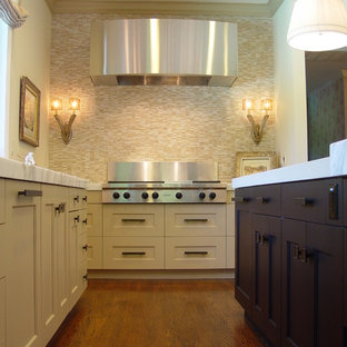 Example of a transitional kitchen design in San Francisco with stainless steel appliances, recessed-panel cabinets, yellow cabinets, beige backsplash and matchstick tile backsplash
