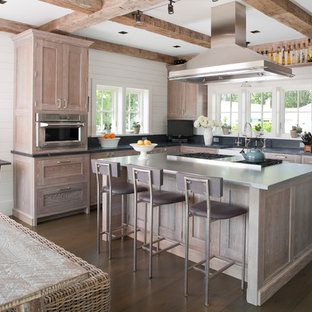 Large coastal eat-in kitchen designs - Inspiration for a large coastal l-shaped dark wood floor eat-in kitchen remodel in Bridgeport with a farmhouse sink, recessed-panel cabinets, distressed cabinets, stainless steel countertops, stainless steel appliances, gray backsplash and an island