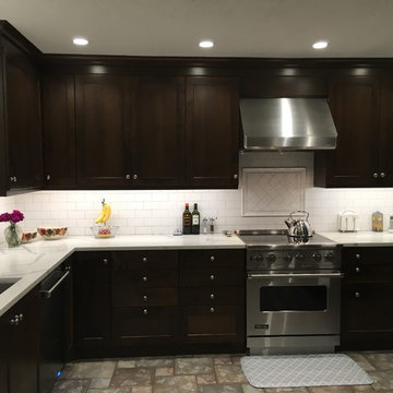 Dark Dramatic Kitchen with Shaker Style Cabinets & White Subway Tile