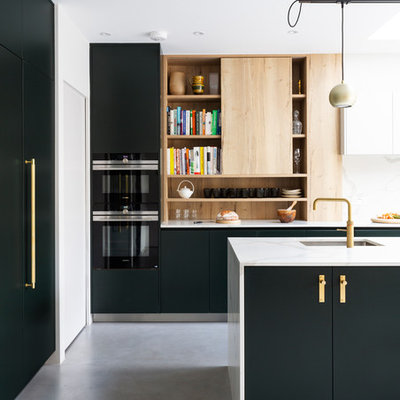 Inspiration for a mid-sized contemporary gray floor and concrete floor kitchen remodel in London with flat-panel cabinets, green cabinets, white backsplash, marble backsplash, an island, white countertops, an undermount sink and marble countertops