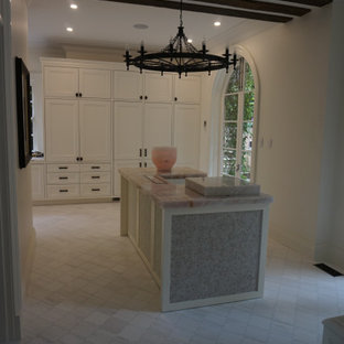 Design ideas for a mediterranean kitchen in Sydney with shaker cabinets, white cabinets, marble benchtops, white appliances, porcelain floors, with island, multi-coloured floor and pink benchtop.