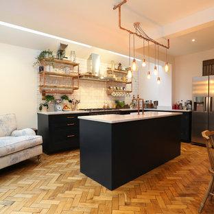 ロンドンのインダストリアルスタイルのおしゃれなキッチンの写真