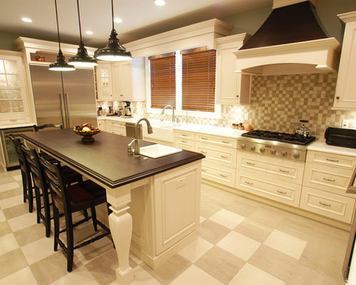traditional kitchen idea in other with stainless steel appliances and