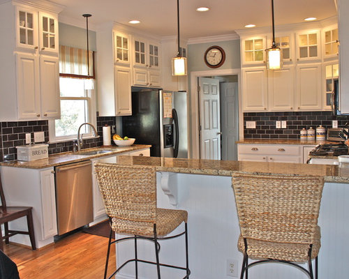 Example Of A Trendy U Shaped Kitchen Design In Charlotte With Raised Panel Cabinets
