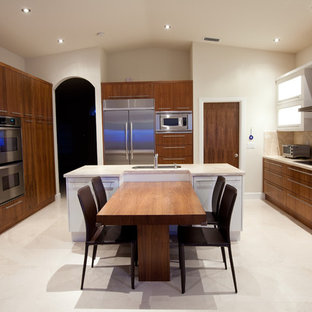 Contemporary kitchen designs - Inspiration for a contemporary kitchen remodel in Miami with stainless steel appliances