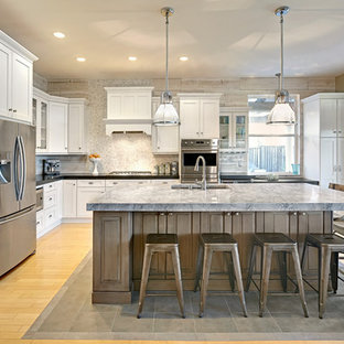 Mid-sized traditional open concept kitchen inspiration - Mid-sized elegant l-shaped light wood floor open concept kitchen photo in Sacramento with an undermount sink, shaker cabinets, white cabinets, quartzite countertops, gray backsplash, stainless steel appliances, mosaic tile backsplash and an island
