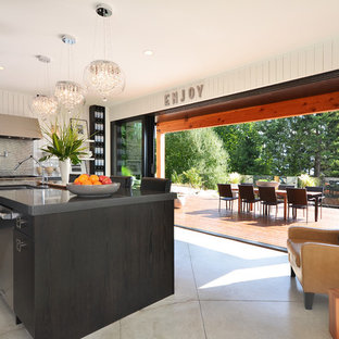 Example of a minimalist kitchen design in Vancouver with stainless steel appliances