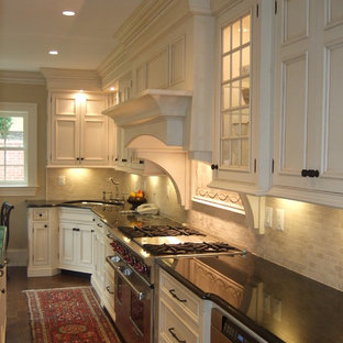 Inspiration for a timeless kitchen remodel in DC Metro with recessed-panel cabinets, stainless steel appliances and travertine backsplash