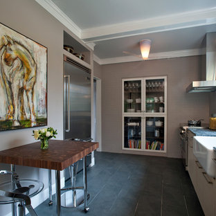 Trendy kitchen photo in DC Metro with a farmhouse sink and stainless steel appliances