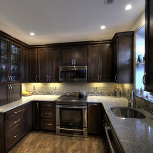 Small traditional u-shaped separate kitchen in DC Metro with an undermount sink, recessed-panel cabinets, dark wood cabinets, granite benchtops, multi-coloured splashback, glass tile splashback, stainless steel appliances, ceramic floors and no island.