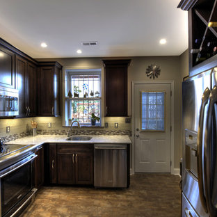 Enclosed kitchen - small traditional u-shaped ceramic floor enclosed kitchen idea in DC Metro with an undermount sink, recessed-panel cabinets, dark wood cabinets, granite countertops, multicolored backsplash, glass tile backsplash, stainless steel appliances and no island