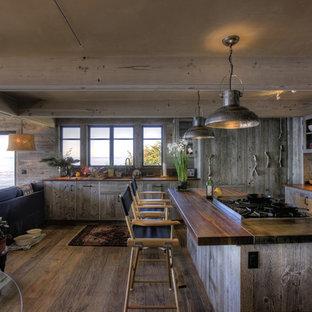 Beach style kitchen designs - Kitchen - beach style kitchen idea in Santa Barbara with wood countertops