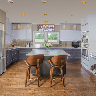 Large contemporary kitchen ideas - Large trendy u-shaped dark wood floor and brown floor kitchen photo in Other with an undermount sink, flat-panel cabinets, gray cabinets, metallic backsplash, subway tile backsplash, stainless steel appliances and an island