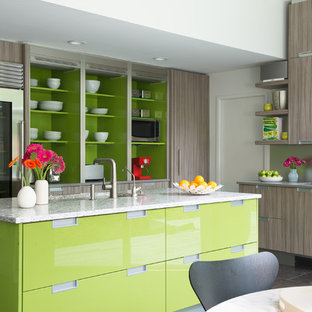 Design ideas for a contemporary l-shaped kitchen/diner in New York with flat-panel cabinets, grey cabinets, metallic splashback, stainless steel appliances and an island.