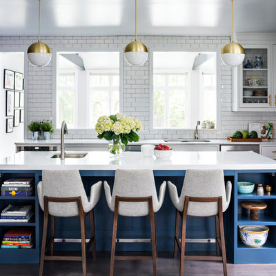 Large transitional l-shaped medium tone wood floor and brown floor eat-in kitchen photo in New York with a double-bowl sink, shaker cabinets, blue cabinets, quartz countertops, white backsplash, ceramic backsplash, stainless steel appliances and an island