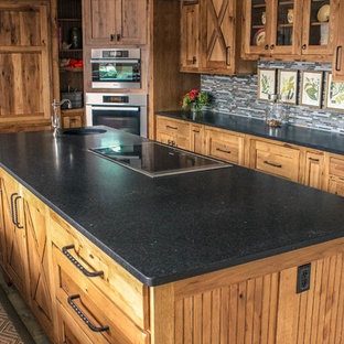 Design ideas for a mid-sized country galley eat-in kitchen in Other with granite benchtops, with island, an undermount sink, shaker cabinets, medium wood cabinets, grey splashback, matchstick tile splashback, stainless steel appliances, limestone floors and multi-coloured floor.