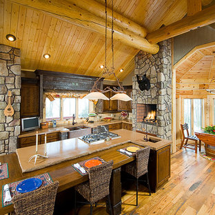 Inspiration for a large rustic medium tone wood floor eat-in kitchen remodel in Other with a farmhouse sink, raised-panel cabinets, medium tone wood cabinets, concrete countertops, brown backsplash, terra-cotta backsplash and an island