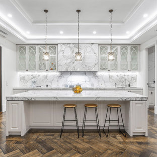 Inspiration for a large transitional eat-in kitchen in Melbourne with an undermount sink, glass-front cabinets, white cabinets, marble benchtops, marble splashback, black appliances, dark hardwood floors and with island.