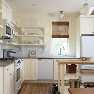 Contemporary kitchen pictures - Kitchen - contemporary l-shaped kitchen idea in Minneapolis with white appliances, a drop-in sink, open cabinets, beige cabinets, laminate countertops, white backsplash and subway tile backsplash