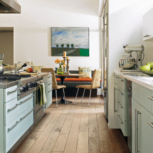 Design ideas for a mid-sized transitional l-shaped open plan kitchen in St Louis with flat-panel cabinets, green cabinets, marble benchtops, stainless steel appliances, plywood floors and with island.