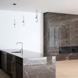 Mid-sized modern eat-in kitchen ideas - Inspiration for a mid-sized modern u-shaped light wood floor and brown floor eat-in kitchen remodel in Los Angeles with a drop-in sink, marble countertops, stainless steel appliances and an island