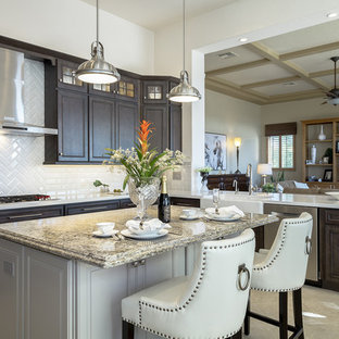 Design ideas for a large traditional open plan kitchen in Phoenix with a farmhouse sink, dark wood cabinets, quartz benchtops, ceramic splashback, stainless steel appliances, porcelain floors, with island, beige floor, recessed-panel cabinets and white splashback.