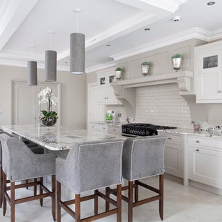 Inspiration for a large transitional open plan kitchen in Other with an integrated sink, beaded inset cabinets, grey cabinets, granite benchtops, beige splashback, subway tile splashback, panelled appliances, ceramic floors and with island.