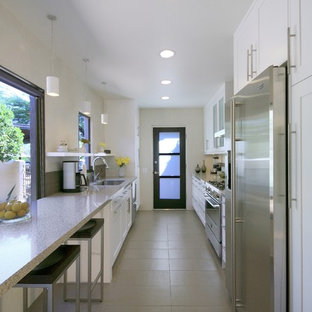 Enclosed kitchen - contemporary galley enclosed kitchen idea in Phoenix with stainless steel appliances and quartz countertops