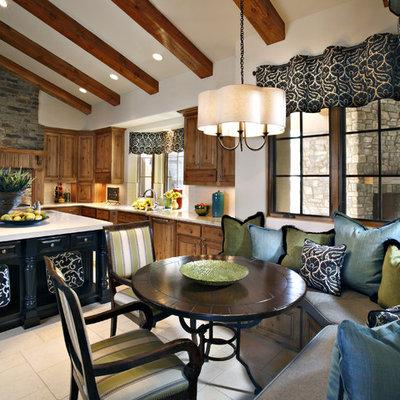 Elegant eat-in kitchen photo in Phoenix with medium tone wood cabinets