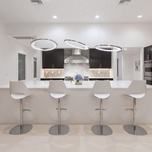 Contemporary kitchen designs - Example of a trendy kitchen design in Las Vegas with shaker cabinets, dark wood cabinets, mosaic tile backsplash, stainless steel appliances, an island and multicolored backsplash