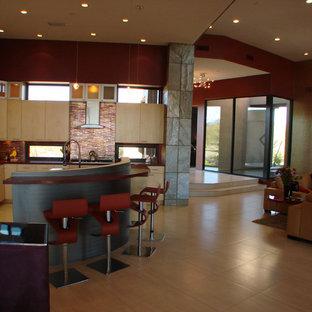 Design ideas for a large transitional l-shaped open plan kitchen in Denver with flat-panel cabinets, beige cabinets, multi-coloured splashback, glass tile splashback, panelled appliances, multiple islands, red benchtop and beige floor.
