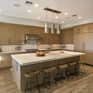 Contemporary kitchen ideas - Trendy l-shaped kitchen photo in Other with flat-panel cabinets, medium tone wood cabinets, multicolored backsplash, paneled appliances and an island