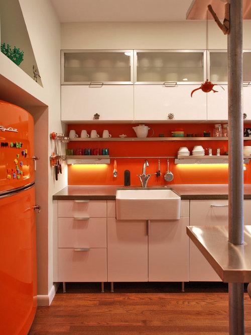 Industrial kitchen idea in DC Metro with a farmhouse sink, concrete  countertops, colored appliances