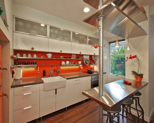 Industrial Kitchen Idea In DC Metro With A Farmhouse Sink, Concrete  Countertops And Colored Appliances