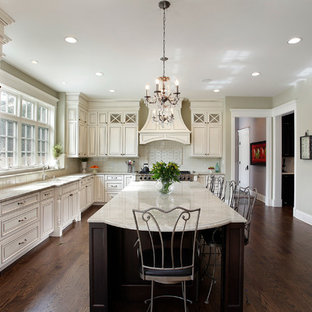 Traditional enclosed kitchen designs - Enclosed kitchen - traditional l-shaped enclosed kitchen idea in Chicago with an undermount sink, raised-panel cabinets, white cabinets and paneled appliances