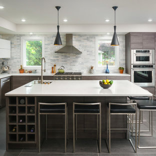 Contemporary enclosed kitchen photos - Inspiration for a contemporary u-shaped gray floor enclosed kitchen remodel in Seattle with flat-panel cabinets, gray cabinets, an island, an undermount sink, gray backsplash and stainless steel appliances