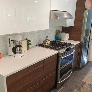 Ispirazione per una piccola cucina minimalista con lavello sottopiano, ante lisce, ante marroni, top in quarzite, paraspruzzi bianco, paraspruzzi con piastrelle diamantate, elettrodomestici in acciaio inossidabile, pavimento in cementine, nessuna isola, pavimento grigio e top bianco