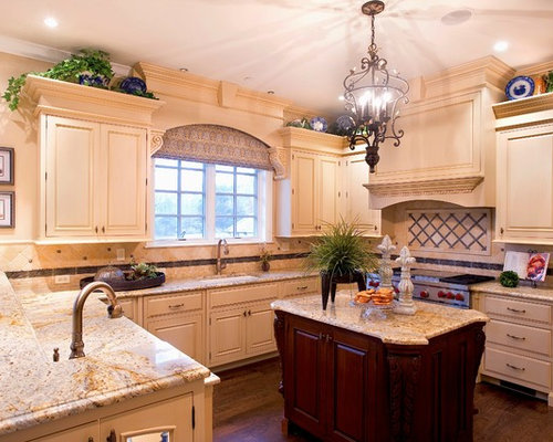 Large Traditional U Shaped Dark Wood Floor And Brown Floor Eat In Kitchen  Idea