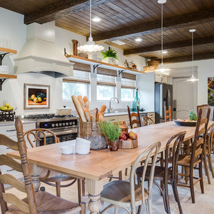 Huge farmhouse eat-in kitchen inspiration - Inspiration for a huge cottage single-wall light wood floor and beige floor eat-in kitchen remodel in DC Metro with raised-panel cabinets, no island, an undermount sink, white cabinets, concrete countertops and stainless steel appliances